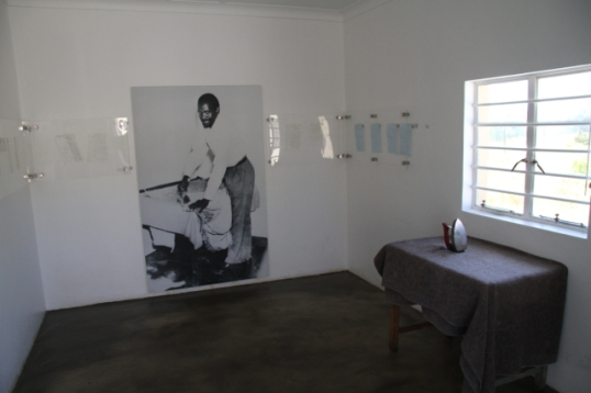 Learning Not To Drown explores the impact that incarceration of a brother has on his sister's life.  I couldn't help but think about the children and wife of Robert Sobukwe.  This room of the small house he was kept in solitary confinement had some letters between him and his wife displayed on the wall.  An adjacent building featured four beds that his children sleep in during their rare visits.