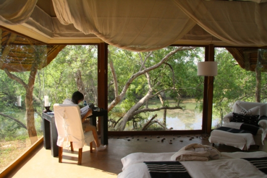Mike caught me reading in our lodge between safari rides.